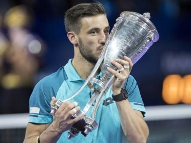 Damir Dzumhur of Bosnia and Herzegovina kisses the trophy after winning the final match against Ricardas Berankis of Lithuania at the Kremlin Cup tennis tournament in Moscow, Russia, Sunday, Oct. 22, 2017. (AP Photo/Pavel Golovkin)
