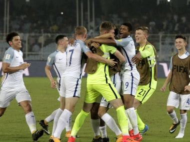 England's footballers celebrate their victory over Japan in their FIFA U-17 World Cup match. AP