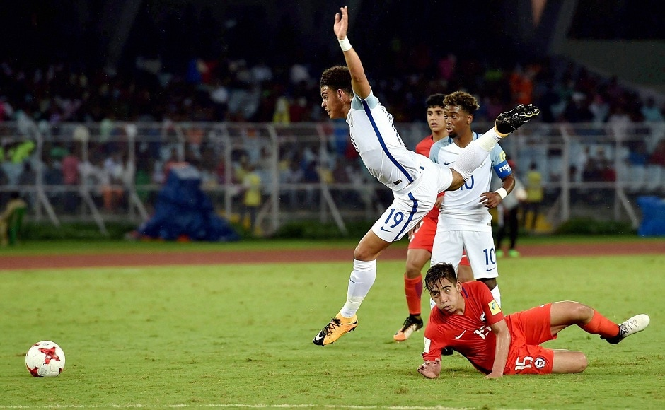 England and Chile players vie for the ball. England scored four goals to start their Under-17 World Cup campaign in style. PTI