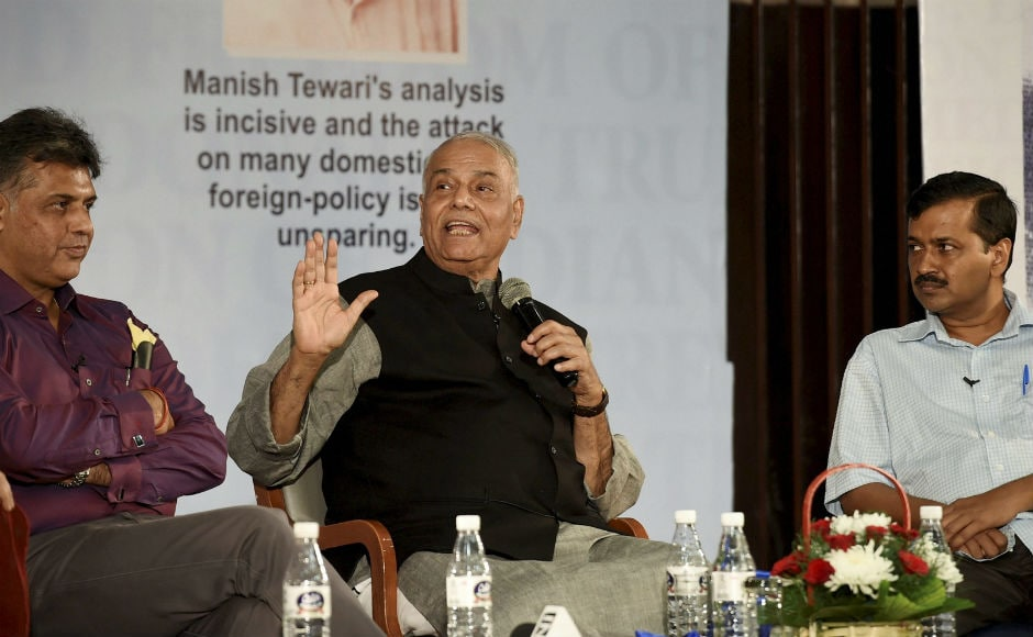 Senior BJP leader Yashwant Sinha on Thursday shared dais with Chief Minister of Delhi Arvind Kejriwal at a function organised for release of Congress' Manish Tewari's book 'Tidings of Troubled Times'. PTI