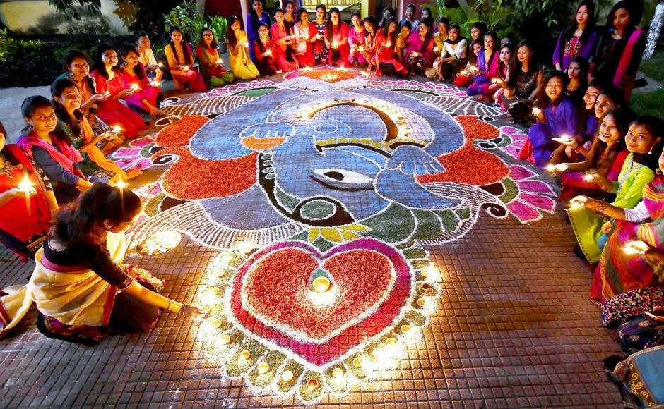 People made rangolis, lighted diyas, and decorated their doorways with garlands made of mango leaves and marigolds. PTI