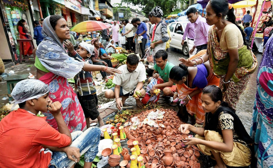 There was festive spirit during the day with people thronging the markets for last-minute shopping. Markets were flooded with decorative items, diyas and marigold flowers. AP