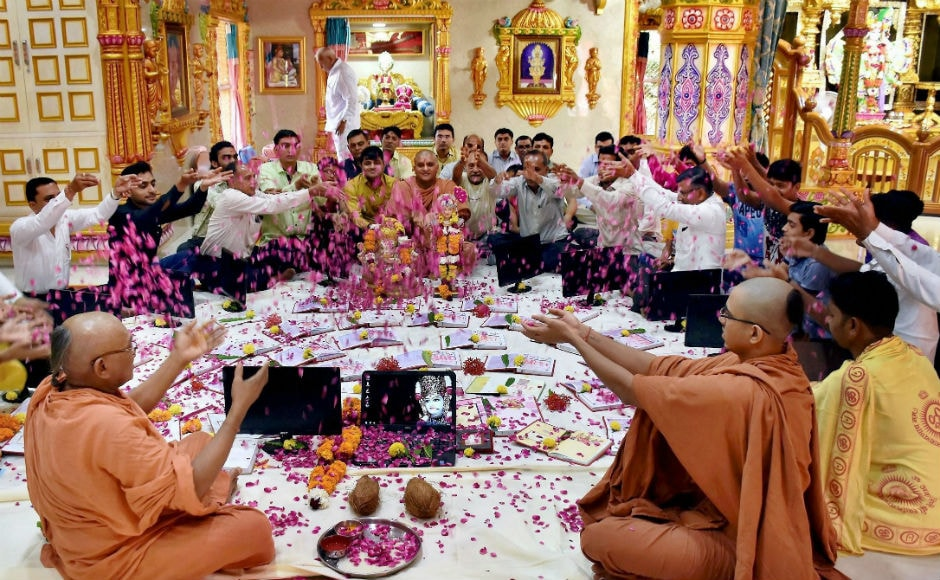 """Called as """"Chopda Poonjan"""", traders workship their account books and computers. The blessing ceremony is performed by priests. AP"""