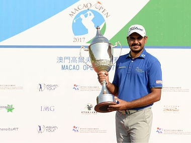India's Gaganjeet Bhullar poses with his trophy after winning the Macau Open 2017. AFP