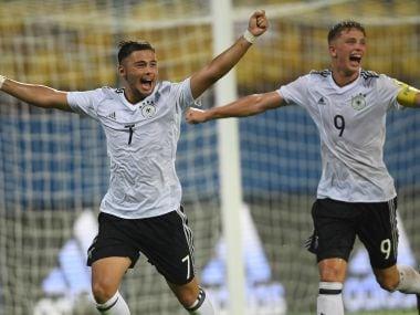 Sahverdi Cetin of Germany celebrates with team mate Jann-Fiete Arp. Getty