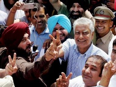 Congress' Sunil Jakhar celebrates winning the Gurdaspur bypoll with Navjot Singh Sidhu. PTI