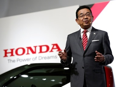 Honda Motor Chief Executive Officer Takahiro Hachigo presents during media preview of the 45th Tokyo Motor Show. Reuters.