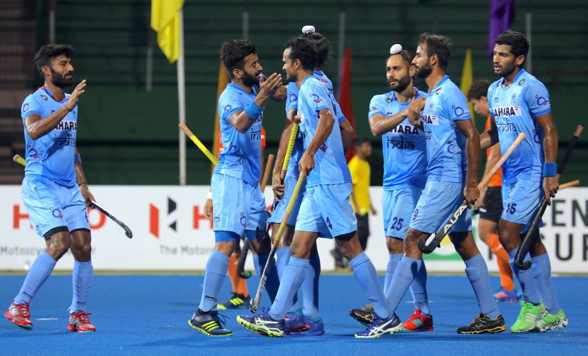 India players congratulate Akashdeep Singh (hidden) after he scored their opening goal. Image courtesy: Neeraj Tiwari