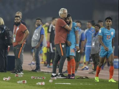 India's coach Luis Norton de Matos hugs Rahim Ali after loosing their match against Colombia during the FIFA U-17 World Cup. AP