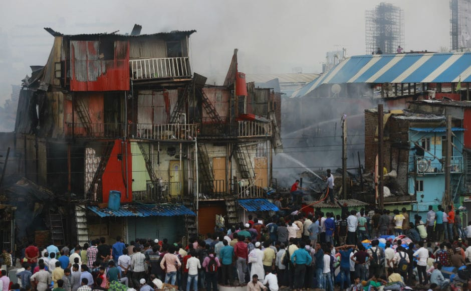 A major fire broke out at Bandra's Garib Nagar slum in Mumbai on Thursday afternoon during a demolition drive and engulfed around 300 hutments and injured four, including one fireman. AP