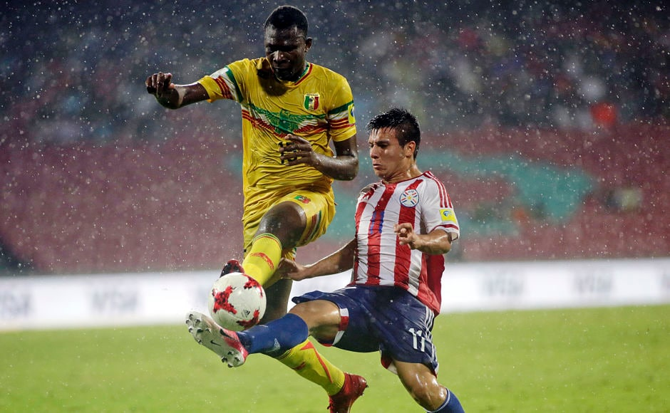 In a group B encounter, Paraguay faced Mali in an exciting encounter that saw Paraguay edge past Mali to win 3-2. Paraguay's football player Leonardo Sanchez tries to take the ball away from Mali's Abdoulay Diaby. AP