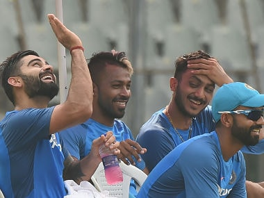 Virat Kohli (L), Hardik Pandya (C), Ajinkya Rahane (R) and Axar Patel talk during a training session at the Wankhede stadium. AFP