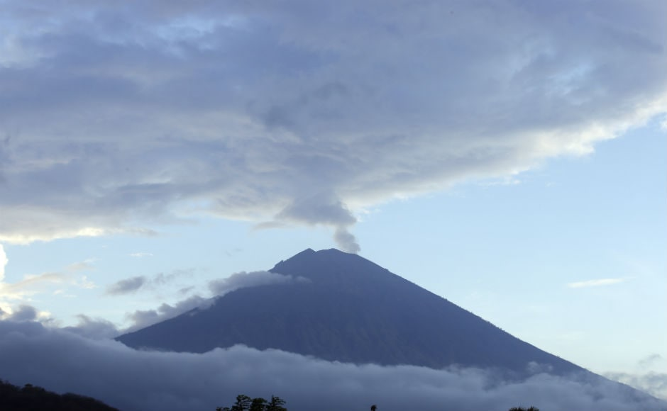 Mount Agung, a rumbling volcano towering over the east of the Indonesian island of Bali, has forced more than 140,000 people to flee as authorities warn that it can erupt at any time. AP
