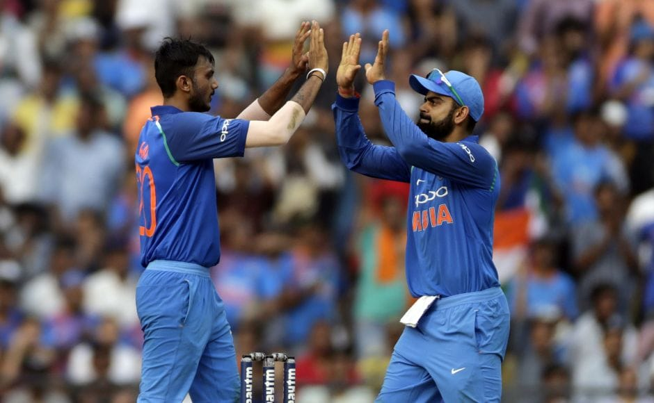 Axar Patel (L) took three wickets as the visitors struggled on a slow wicket and werereduced to 118-4. AP
