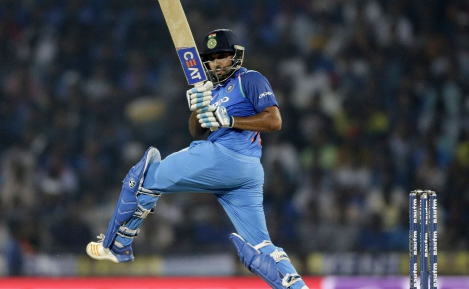 On a slow, tough wicket, the duo put on 50 off 69 balls and then crossed the 100 mark off 113 balls. Rohit Sharma reached his half-century off 52 balls. AP