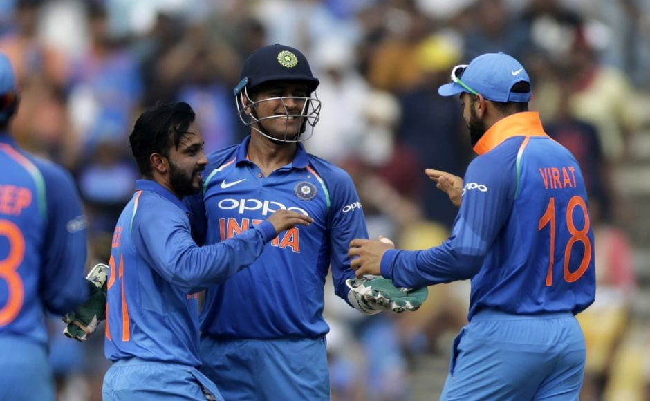Kedar Jadhav (L) provided the second breakthrough as he trapped Smith lbw shortly thereafter with the Australian skipper out sweeping. AP