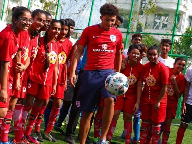 Jadon Sancho of England plays football with young children from the Kolkata Outreach programme for a community activity ahead of the FIFA U-17 World Cup India 2017. Getty