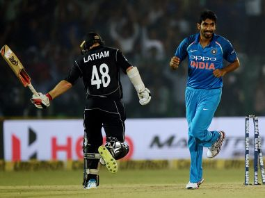 Jasprit Bumrah (R)  celebrates after dismissing Tom Latham (L) during the third ODI between India and New Zealand. AFP