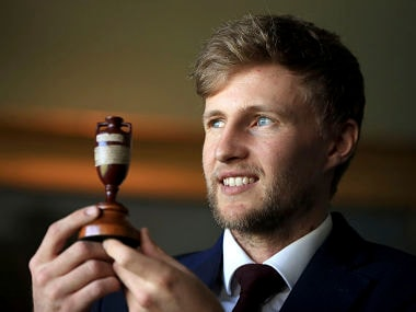 England captain Joe Root holds the Ashes trophy as he faces the media at Lord's in London. AP
