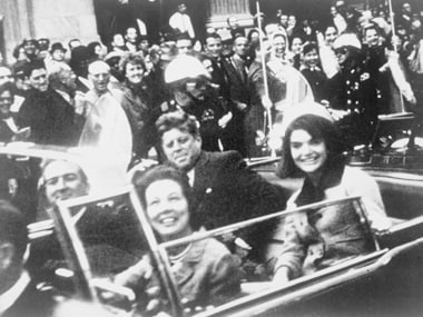President John F Kennedy (C), first lady Jacqueline Kennedy (R) and Texas Governor John Connally (L) and his wife are pictured riding in the presidential motorcade moments before Kennedy was shot. Reuters