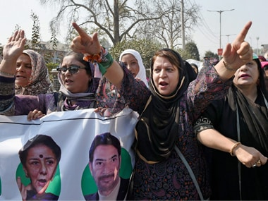Women workers of congress shouting slogans and blocked the road during protest against braid choping incidents in the Valley in Srinagar. PTI