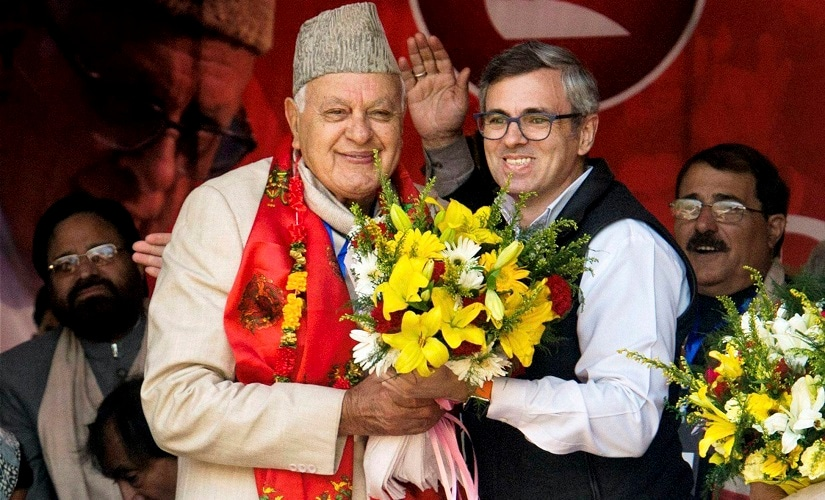 National Conference president Farooq Abdullah with son Omar. PTI