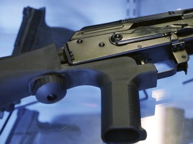 """File image of a """"bump stock"""" attached to a semi-automatic rifle. AP"""