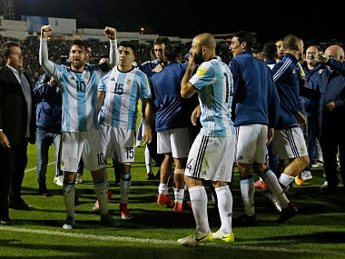 Argentina's Lionel Messi, left, celebrates with his team after beating Ecuador during their 2018 World Cup qualifying soccer match at the Atahualpa Olympic Stadium in Quito, Ecuador, Tuesday, Oct. 10, 2017. (AP Photo/Fernando Vergara)