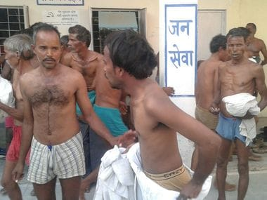"a group of farmers returning from a protest for declaring Tikamgarh as a drought-hit district were ""detained, stripped and beaten up"" by the police on Tuesday . CNN-News 18"