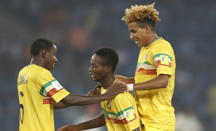 Mali's Djemoussa Traore, center, and others celebrate a goal during the FIFA U-17 World Cup. AP