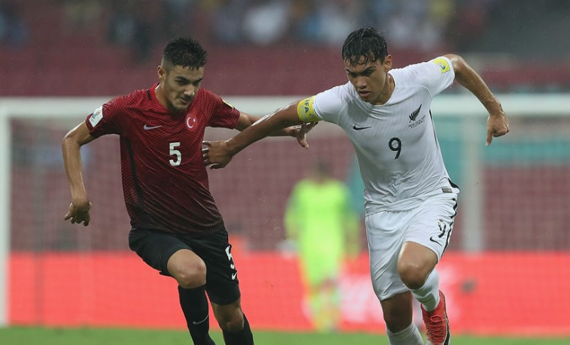 Max Mata of New Zealand holds off Ozan Kabak of Turkey during the FIFA U-17 World Cup India 2017 group B match between New Zealand and Turkey at Dr DY Patil Cricket Stadium. Getty Images