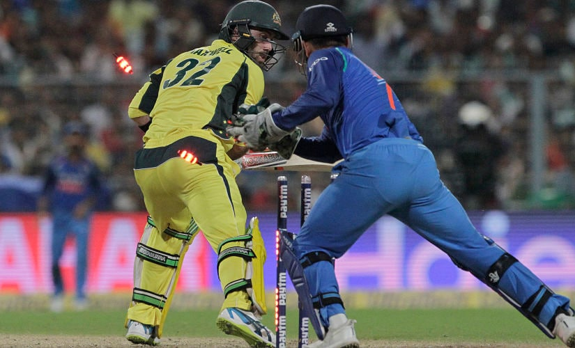 Australian cricketer Glenn Maxwell looks back to see India's Mahendra Singh Dhoni successfully stumping him during the second one-day international cricket match at Eden Gardens in Kolkata, India, Thursday, Sept. 21, 2017. (AP Photo/Bikas Das)