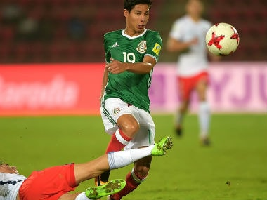 Diego Lainez of Mexico and Martin Lara of Chile in action. Getty Images