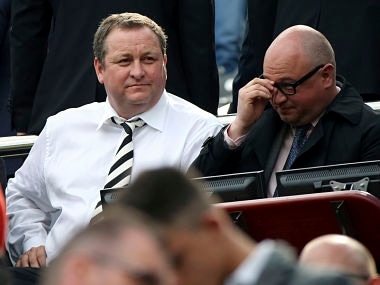 File image of Newcastle United's owner Mike Ashley, left, and managing director Lee Charnley, right, are seen in the stand. AP