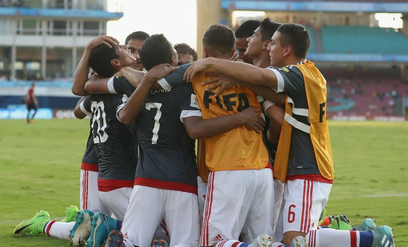 Paraguay players form a huddle after Giovanni Bogado scores a goal. Getty Images