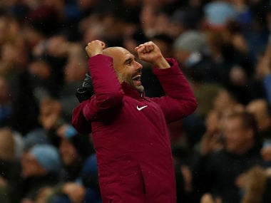 Manchester City manager Pep Guardiola celebrates after Leroy Sane scored their third goal. Reuters