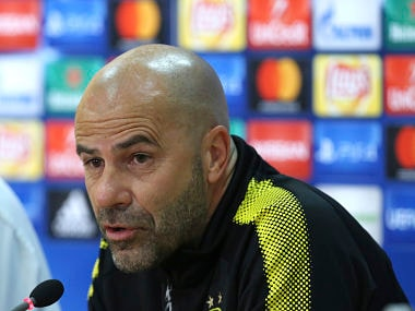 Dortmund manager and head coach Peter Bosz talks to the media during a press conference. AP