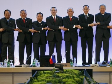 ASEAN Defense link arms during a brief photo session at the start of the ASEAN Defense Ministers Meeting. AP