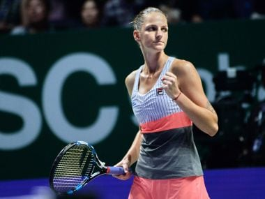 Karolina Pliskova of the Czech Republic reacts on a point against Venus Williams of the US during the WTA Finals tennis tournament in Singapore on October 22, 2017. / AFP PHOTO / Roslan RAHMAN