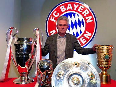 Treble-winning Bayern Munich coach Jupp Heynckes poses with the German soccer cup (DFB Pokal), Champions League, German soccer championship Bundesliga and the super cup trophies in Munich June 4, 2013. Heynckes will take time out next season but fell short of announcing his retirement on Tuesday following his club's most successful season to date. REUTERS/Michael Dalder (GERMANY - Tags: SPORT SOCCER) - BM2E96413VS01