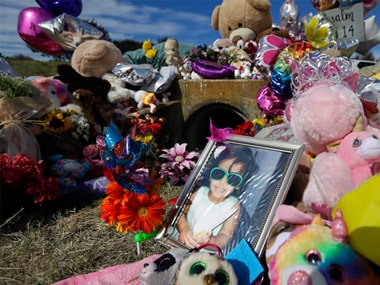 File image of a photograph of 3-year-old Sherin Mathews at a makeshift memorial in Richardson. AP