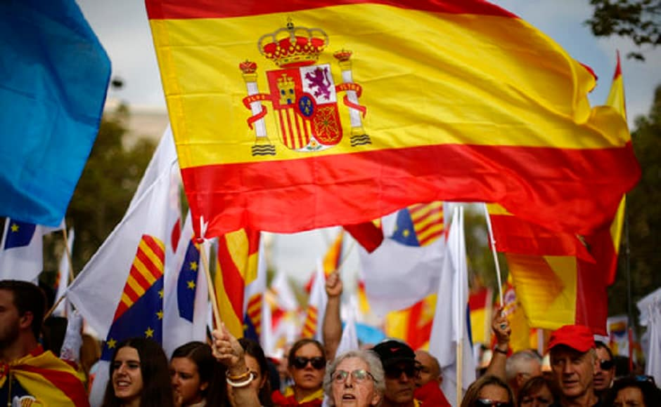 Spain marks its national day on Thursday with show of unity by opponents of Catalan independence referendum . AP