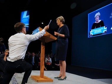 Theresa May interrupted by a prankster. AP