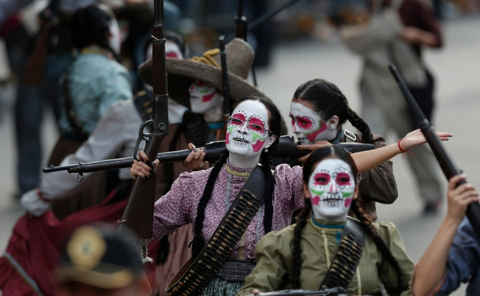 This year's parade featured a kilometre and a half of floats honouring the celebration, which is an amalgam of pre-Hispanic and other traditions. AP