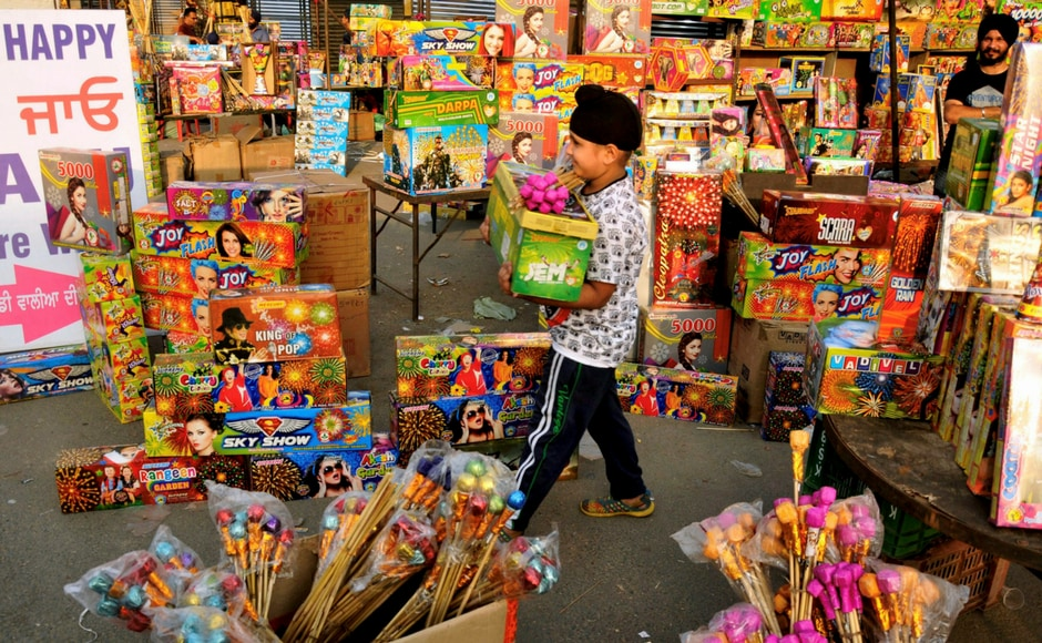 A child buying firecrackers on the eve Diwali festival, in Amritsar on Wednesday. PTI