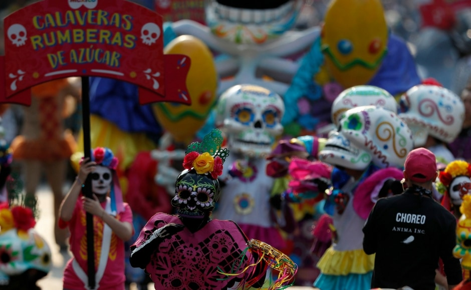 The Day of Dead celebrations traditionally consisted of quiet family gatherings at the graves of their departed loved ones bringing them music, drink and conversations. AP