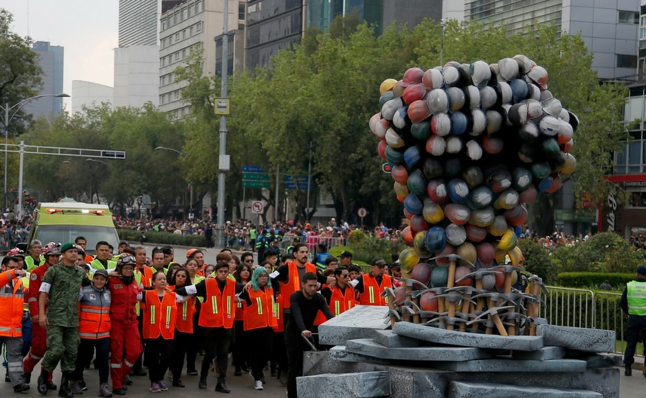 """""""Many are afraid of death but no, its part of life,"""" said Leo Cancino, who took his family to see the parade in Mexico City. AP"""