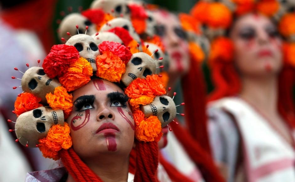 But it is increasingly celebrated with parade rife with floats, giant skeleton marionettes and thousands of participants. AP