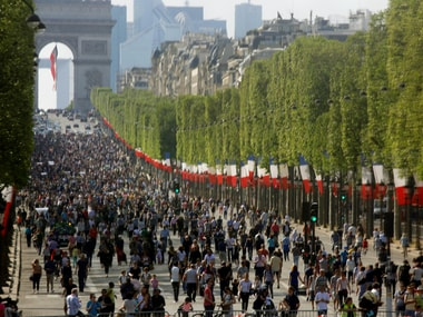People walk on the car-free Champs-Elysees avenue in Paris, France, May 8, 2016. Reuters