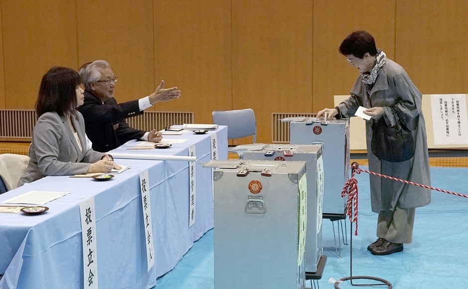 Polling stations opened across Japan at 7 am (local time) with voters battling high winds and driving rains as an election-day typhoon barrelled towards the island country. AP